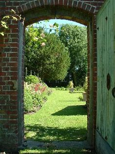 Opening the gate into a secret garden in St. Mary's Bramber