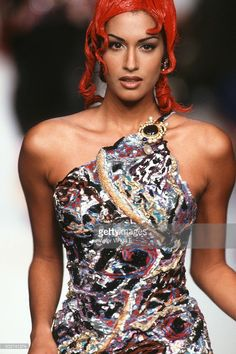 Yasmeen Ghauri walks the runway during the Chanel Haute Couture show as part of Paris Fashion Week Fall/Winter 1992-1993 in July, 1992 in Paris, France.