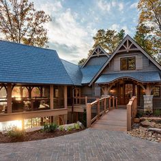 My dream house....perfect  coffee drinking porch.  A bridge to the front door and a covered gazebo that connects the main house to the garage?! Sign me up! | by Ridgeline Group |
