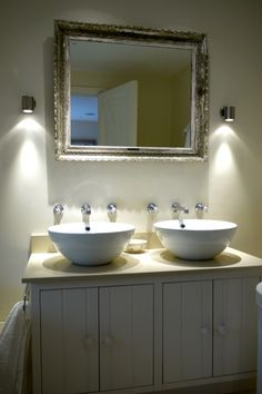 Twin sinks with statement lighting