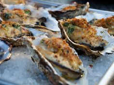 Grilled Oysters Rockefeller with Baby Spinach Bacon Fondue recipe from Guy Fieri via Food Network