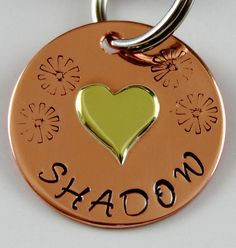 Give your furry best friend, or a furry friend you know this mixed metal Pet Name Tag. The Brass Heart is custom cut from a piece of 20 awg brass sheet metal. The Copper disk is hand stamped with your pets name  symbol stamped (Sunray's) on one side and on the other side your phone number if you wish. The two are then soldered together, sanded and polished to a shinny finish . What a way to show how much you love and value your pet than with this custom hand stamped mixed metal pet name tag.