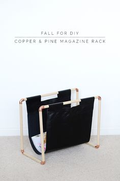 copper pipe fittings, pine dowels, and fake leather magazine rack diy. I love this!