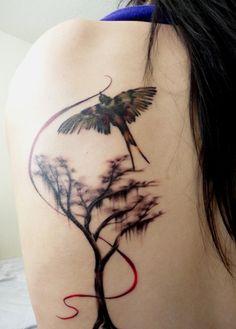 Gorgeous tree and bird tattoo