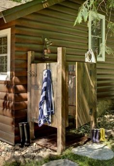 outdoor shower: let's add towel hooks on outside, flag thing around the top, gingham stapled over the gaps in sides