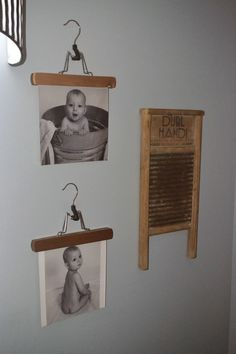 Such a cute and cheap idea!! Use pants hangers to hold pictures in the laundry room! #laundryroom #pantshangers #wallart