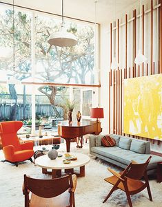 Mid-century with pops of color. Floor to ceiling window.