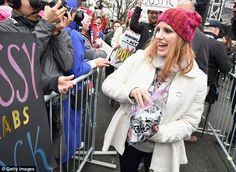 Pin up girl: The Interstellar star passed out pins to protesters watching the stage...