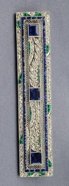 Rosamaria G Frangini | High Antique Jewellery | Art Deco Platinum, Sapphire, Diamond, and Emerald Brooch | www.skinnerinc.com/