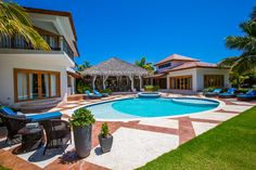 Arrecife Estate villa, The Estates at Puntacana. Designed and constructed by Grupo Dupla, Dominican Republic. #dominicanrepublicrealestate,  #luxuryrealestate, #luxuryhomebuilder, #design, #architech