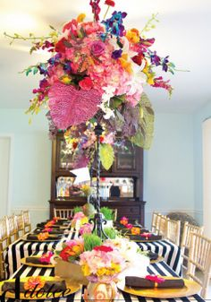 Use big, bright flowers with black & white striped accents for a pretty summer table setting!