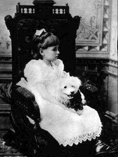 Helen Keller (1880 - 1968), political activist and author, photographed here as a child while holder her pet dog,  c.1887. Keller graduated from Radcliffe College, and became the first deaf-blind person to earn a Bachelor of Arts degree. ~ {cwlyons}