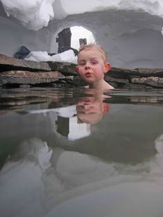 Three year old boy in geothermal pool in the winter time. Picture is taken in end of January 2013 in Laugarfell Highland Hostel.  www.highlandhostel.is