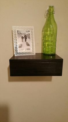 Check out this item in my Etsy shop https://www.etsy.com/listing/269732986/rustic-wood-floating-shelf-with-hidden