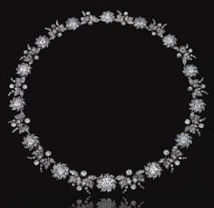 DIAMOND NECKLACE, MID 19TH CENTURY.  Designed as a graduated series of flower head clusters set with old-mine diamonds and embellished with rose-cut diamond points, interspersed with similarly-set vine leaf motifs,