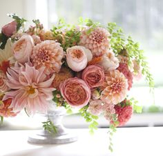 Gorgeous compote of peaches and crème flowers - dahlias, roses, maidenhair fern,...