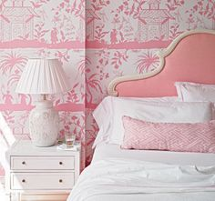 pink & white beach inspired bedroom. love the pink headboard and toile wallpaper