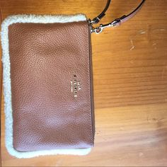 COACH Wristlet Beige leather Wristlet! Perfect size for bank cards cash or change to carry out with you! Smaller phones will fit inside! Has a soft fur outline! Slightly used just like brand new! Coach Bags Clutches & Wristlets