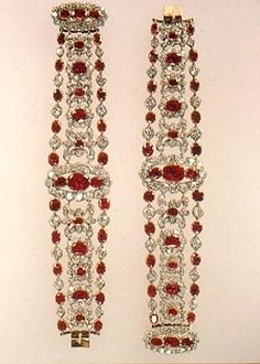 Bracelets of a large parure belonging to Marie~Therese... It was one of the crown jewels of France that came from the collection founded in 1530 by Francois I. Marie~Louise wore these jewels on her wedding day and after the fall of the Empire and the restoration of the Bourbon Monarchy they went to Marie~Therese.