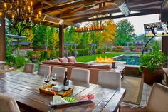 There isn't much this outdoor living space is lacking. It has a covered patio, full length dining table, an outdoor cooking space and television. Sammamish, WA Coldwell Banker BAIN
