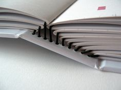 elastic binding for pamphlet stitchbooks - good way to bind serials