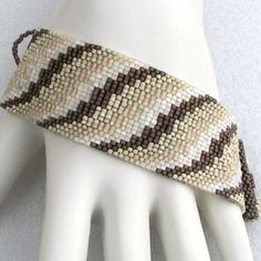 Cream Bargello Ribbon Peyote Cuff by Sand Fibers on Etsy Peyote Beading, Beaded Bracelet Patterns, Peyote Patterns, Weaving Patterns, Beaded Bracelets, Foot Bracelet, Thing 1, Necklaces, Arm Candies