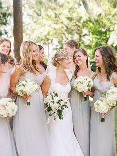 bridesmaids in pale gray