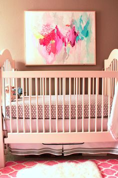 I really like the material for the bedding in this picture. Really great for a gender neutral nursery.