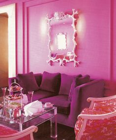 Yeah, you go, velvet purple couch. (Digging the white coral mirror frame against the pink.)