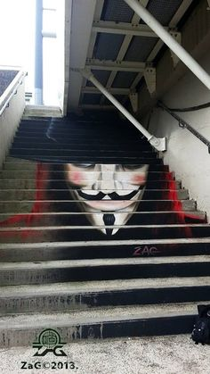 Anamorphic Guy Fawkes Graffitti by ZAG  Located at the Recouvrance Bridge in Pont de Recouvrance