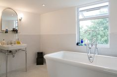 Open plan classic bathroom in a l-section loft conversion built by Simply Loft in South East London