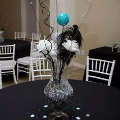 One of the many different centerpieces black white and aqua wedding