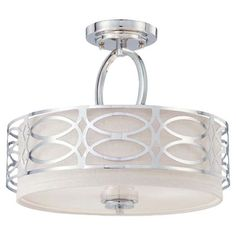 Metal semi-flush mount in polished nickel with latticework overlay and an interior fabric drum shade.   Product: Semi-flush mou...