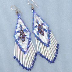 Blue White Brown Delica Beads Turtle Beaded Earrings , Pair of Earrings beautifully hand beaded with small size 11/0 Cz Seed Beads.Delica Beads Color Blue, Silver White,Tube 1 Inch. Earwires Are Made Of White Metal With 0.925 Silver Plating Oxidized Nickel Free..Metal :.925 Sterling Silver PlatedBeads :Cz Seed BeadsWeight :14.0gLength :4.8 inch including Ear WireMax Width :1.1 inch[No:E-26-SB-3]