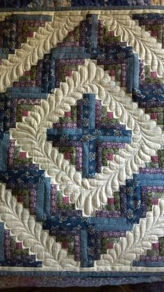 Log Cabin quilt by Harriet Carpanini.  Not only is it on point but the quilting is just beautiful