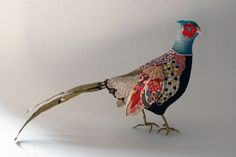 Josephine Hague's colorful cloth-covered bird models roost on mirrors and lend a whimsical air to their surroundings. The Somerset-based artist compri