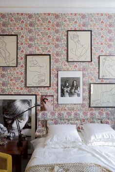 Polka dot bedding and granny floral wallpaper with a killer gallery wall and a pop of yellow. Yes please.