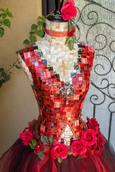 """WOW! """"Don Quixote"""" dress form Mannequin Mosaic Art. Glass mosaics in silver, white, beige, variations of black & red glass mosaic tiles. Adorned with a black and silver rhinestone brooch. The skirt is made with layers of red & black tulle and embellished with red roses & red ribbon. The neck has a red ribbon with a flower and the top has red jewels around the top. ~ By Mosaicsbycarrie on Etsy $2800."""