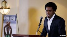 Rio Olympic marathon silver medalist Feyisa Lilesa of Ethiopia attends a news conference in Washington, Sept. 13, 2016.