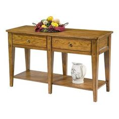 """Hand-finished console table with antiqued brass hardware.   Product: Console tableConstruction Material: WoodColor: OakFeatures:Hand-finishedAppealing planked top and tapered legs Dimensions: 29"""" H x 48"""" W x 18"""" D"""