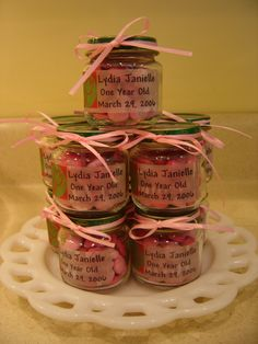 First Birthday party favors - I filled my daughter's baby food jars with pink m&ms, printed clear labels to stick to the jar, and fastened a pink ribbon around the cap with a dot of glue to hold it in place.