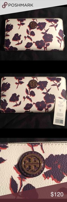 Tory Burch Wallet NWT included, flowers are dark purple and orange, and the wallet is a cream color. Beautiful wallet with one zippered pocket in the middle and many slots for cards on each side. Tory Burch Bags Wallets
