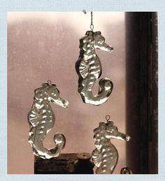 Glass Seahorse Ornament. Realistically detail natural elements surprise when rendered in recycled glass. Our Seahorse Ornament features detailed fins, spine and curled tail. When not adorning and sparkling  on the tree, hang from a window, for a seaside sun catcher.