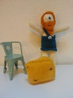 This is a knitted Cyclops with his cheese