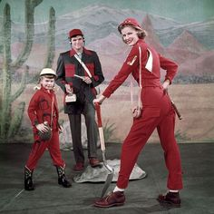 In this unpublished 1955 fashion shoot LIFE showcases what you need to wear to be an amateur Uranium prospector. Pictured here is a young girl in a 'Diggerette Jr. Suit' Dad in a 'Smock Suit' and Mom wearing a 'U235 Suit.' And of course don't forget your Geiger counter! (Nina LeenThe LIFE Picture Collection/Getty Images) #fashionfriday by life