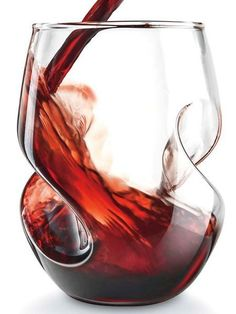 Swirl Red Wine Glasses (set of 4) - The curved design of the Swirl Red Wine Glasses aerates wine for the best flavor. Get it now on Solutions.com #WineGlasses