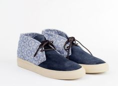 Just in time for the beginning of Spring 2013, Italian based shoemaker, Buttero presents the Jacquard Chukka. For those of us that like our mute tones, the toe box and tongue feature a vegetable navy suede upper. Signifying the seasonal change, the upper is contrasted with a floral jacquard fabric....