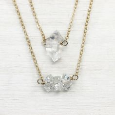 These herkimer diamond layering necklaces are just delightful - they flicker and reflect light from both the gold chain and from the beautiful herkimer stones. The stones feature the occasional imperf