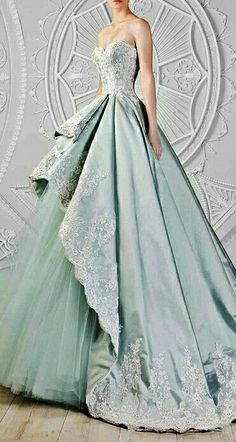 Beautiful ice teal color, and there's so much detail on the bodice, and the cut and folds of the skirt, wow. So pretty!