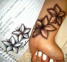 Hibiscus or plumeria tattoos